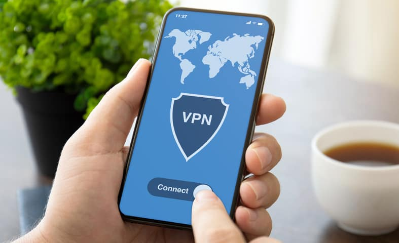 An image of a person configuring a VPN on an iPhone