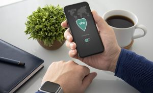 an image of a person wearing a smartwatch using a VPN on a phone