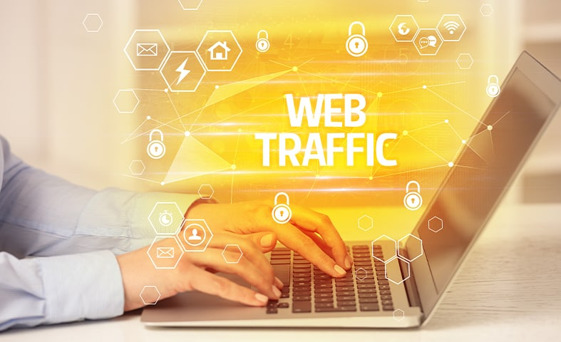 a person using his laptop to generate web traffic