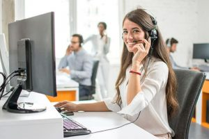 An image featuring a customer service support agent working in a call center
