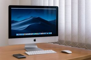 An image featuring an MacOS device with a mac keyboard and mouse