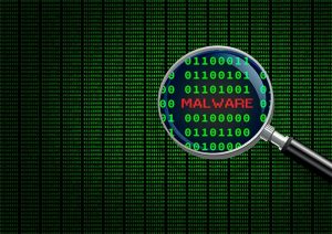 An image featuring an magnifying glass enlarging malware in computer machine code