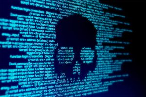 An image featuring a skull made out of code representing a cyber attack