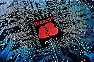 An image featuring a motherboard that says breach on it with red color representing data breach