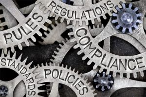 An image featuring multiple cogs that say regulations and policies concept