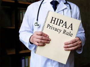 An image featuring a doctor standing and holding the HIPAA privacy rule
