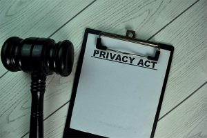An image featuring a privacy act concept with a gavel next to it
