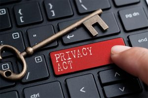 An image featuring a keyboard that has a red privacy act button with a key next to it representing privacy law concept
