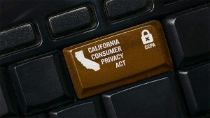 An image featuring a keyboard with the enter key replaced with a custom brown key that says California consumer privacy act on it representing CCPA concept