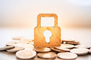 An image featuring financial privacy concept with a lock and money on the bottom