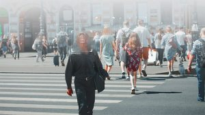 An image featuring multiple people in public having their faces blurred representing privacy of identity