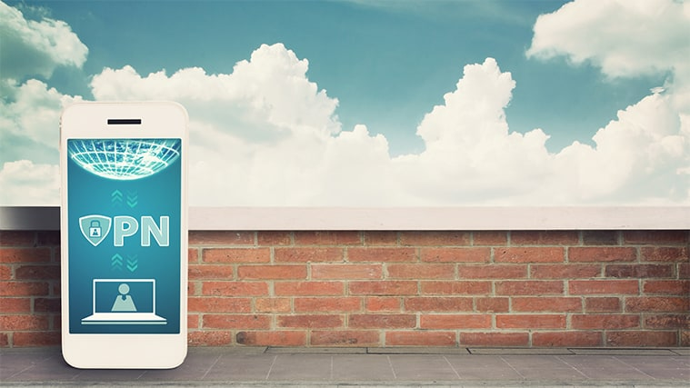 An image featuring a phone next to a wall with a VPN service on it representing VPN concept