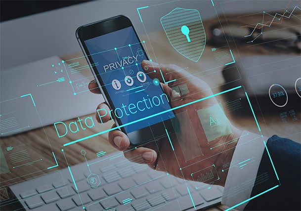 An image featuring a person holding his phone with an antivirus logo and that says data protection representing informational privacy concept
