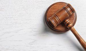 Judge's gavel on light background