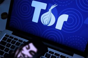 an image with tor logo on background on laptop